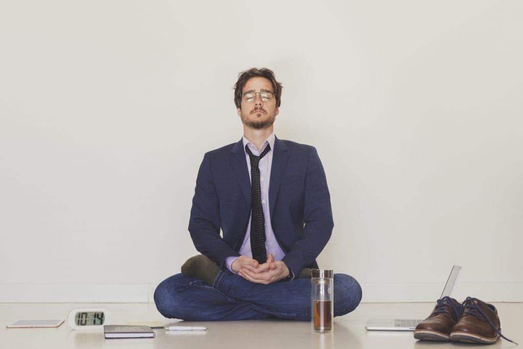 university student sitting meditating quiet space