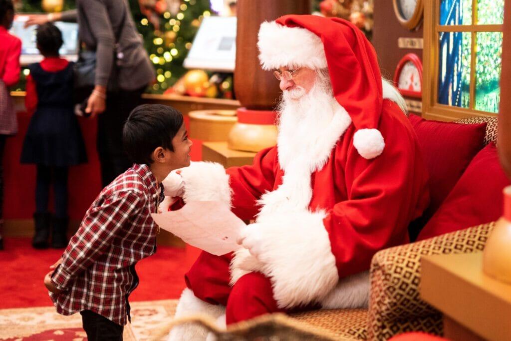 Young boy visiting Santa