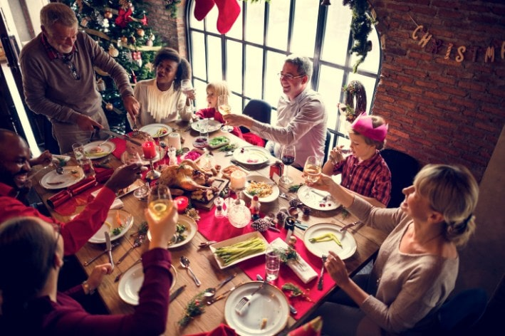 Family gathered at table for holiday dinner.