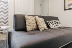 Grey couch with pillows.