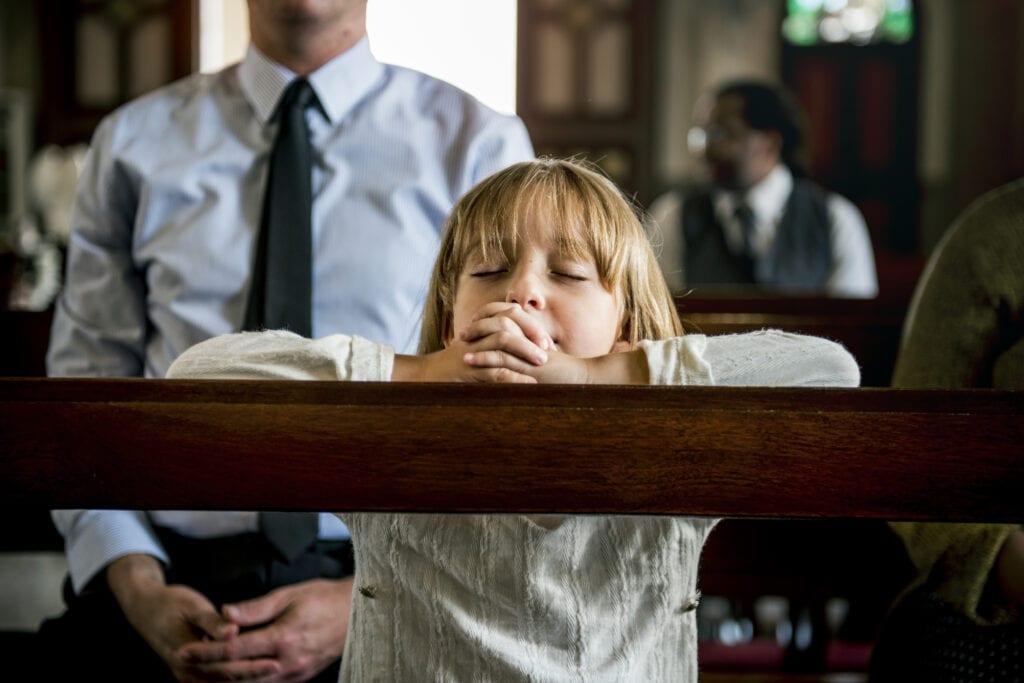 Girl praying at sensory friendly church.