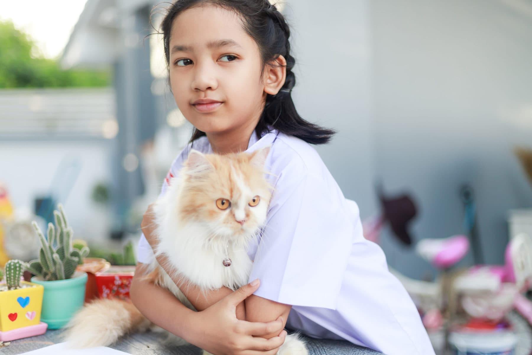 Anxious girl hugging her cat.