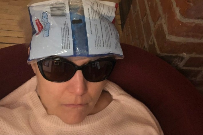 Yona Landry with sunglasses and an ice pack on her head post-concussion.