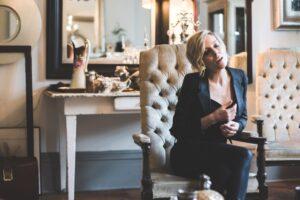 Christina Martin sitting on chair.