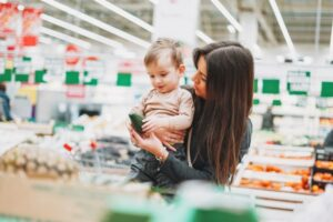 Mother and son grocery shopping.