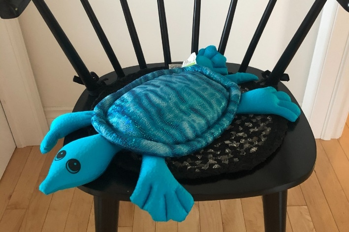 Turtle shaped weighted lap pad.