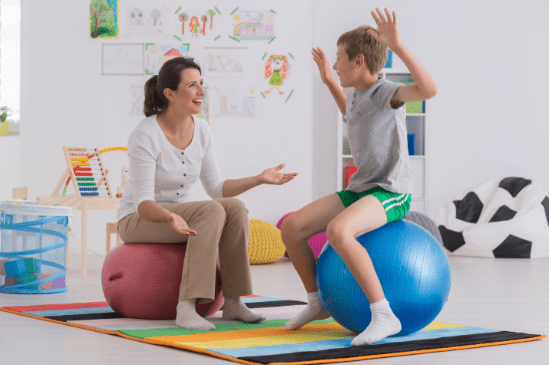 Mother and son sitting on exercise balls.