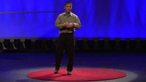 Dr. Bill Wong speaking on stage at his TEDx talk
