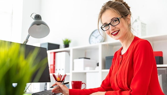 Women in red shirt at her home office