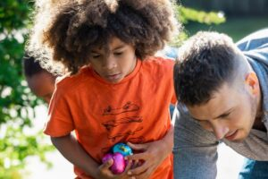Image of boy holding eggs on a sensory-friendly Easter egg hunt