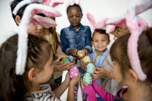 Group of kids on Easter holding Easter eggs.