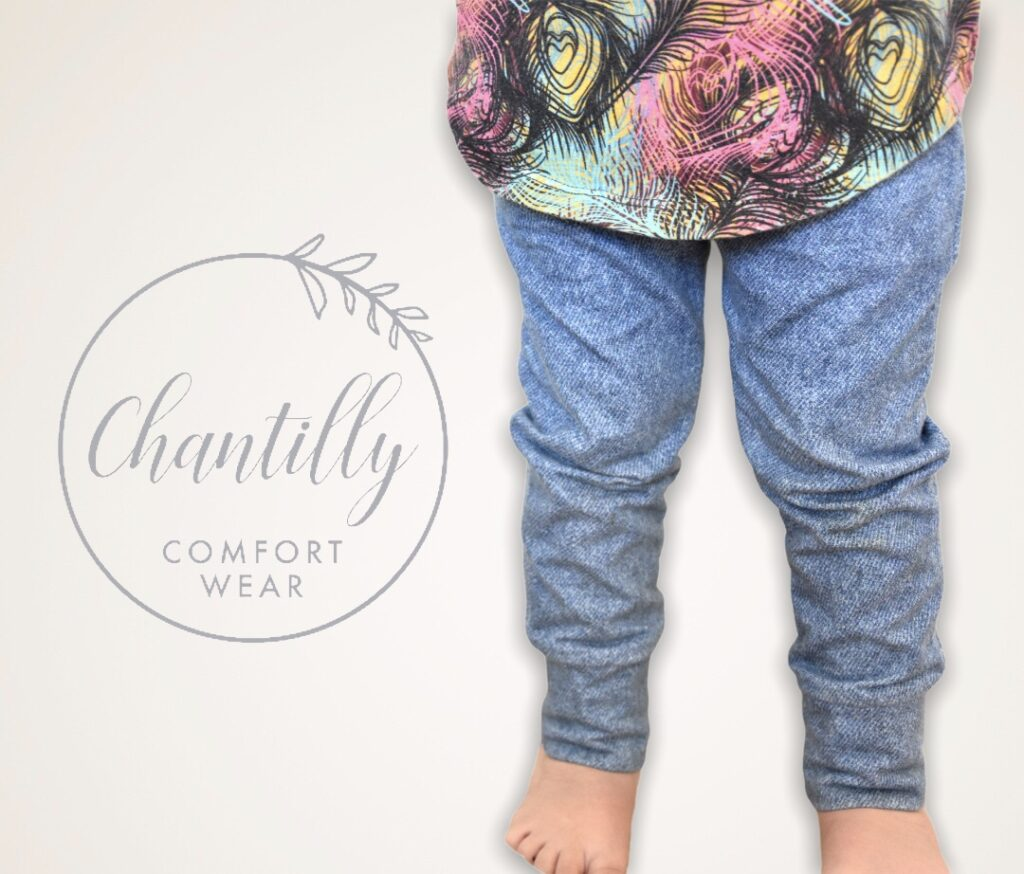 Young child posing in Chantilly pants and shirt.