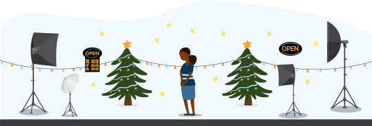 Illustration of a person having their photo taken indoors with a Christmas scene. There are lots of lighting equipment set up around the person.