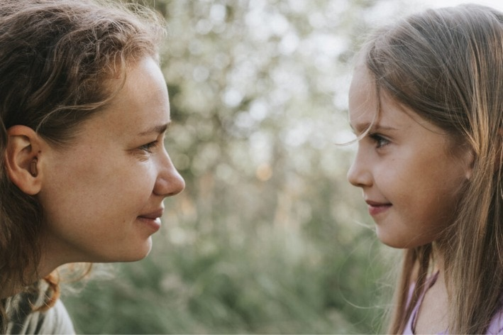 Women and child looking into eachother's eyes.