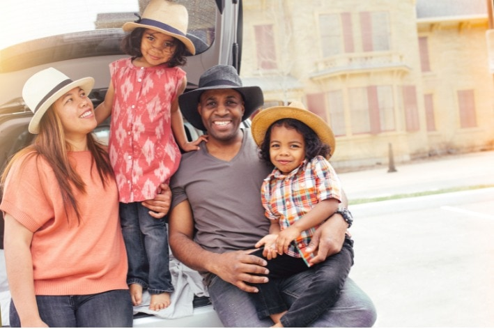 Young family touring a city on a sensory-friendly vacation.