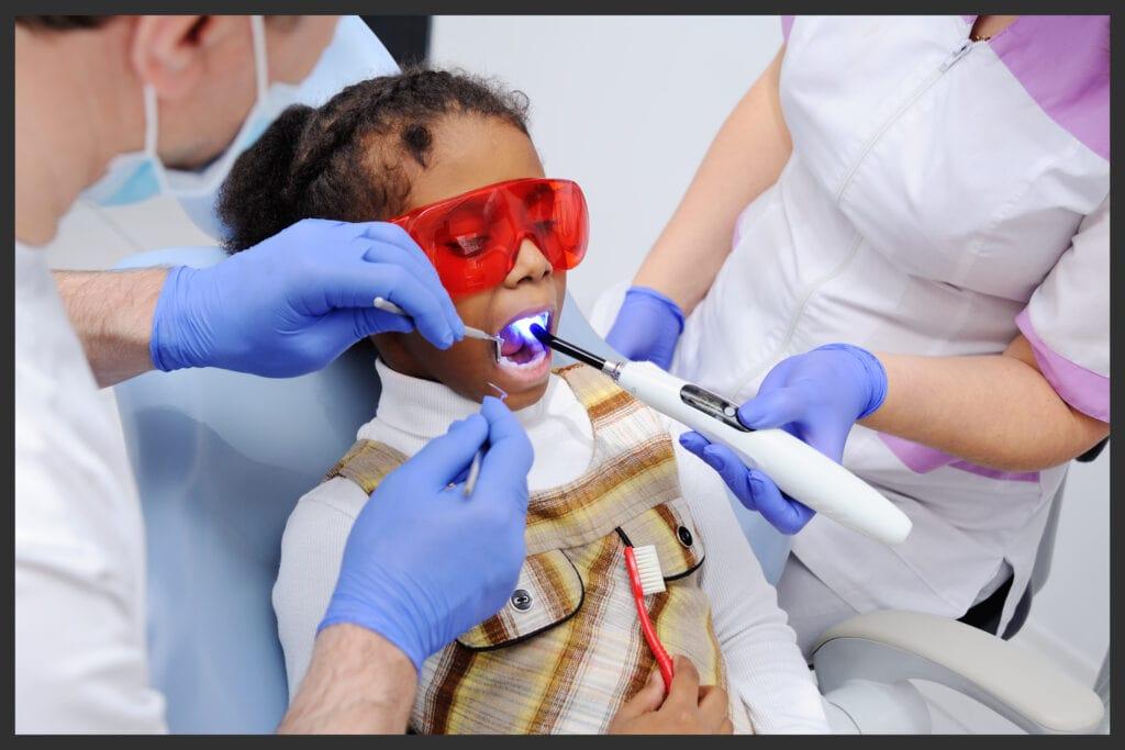 African American girl receiving sensory-friendly dentistry