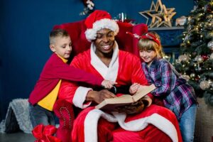 Santa claus reading a story to two children